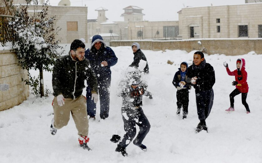 Palestinians play in the snow in the West Bank city of Nablus on Feb. 20.