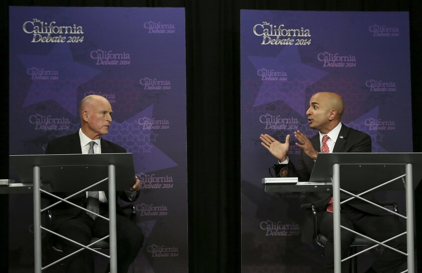 Gov. Jerry Brown, left, listens as Republican challenger Neel Kashkari speaks during a gubernatorial debate in Sacramento, Calif., Thursday, Sept. 4, 2014. Thursday's debate is likely to be the only one of the general election. (AP Photo/Rich Pedroncelli, Pool)