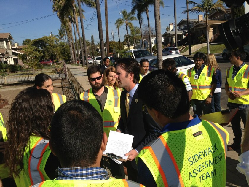 Councilman Mark Kersey with the city's sidewalk assessment team