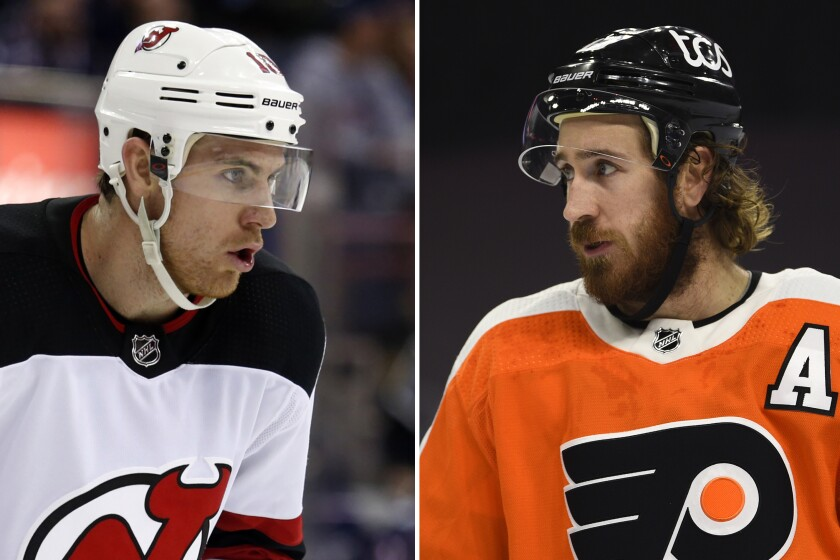 FILE - At left, in a Dec. 5, 2017, file photo, New Jersey Devils' Jimmy Hayes plays against the Columbus Blue Jackets during an NHL hockey game in Columbus, Ohio. At right, in a Tuesday, Jan. 19, 2021, file photo, Philadelphia Flyers' Kevin Hayes plays against the Buffalo Sabres in Philadelphia. Kevin Hayes spent a life in step with big brother Jimmy, a couple of kids from Boston's largest neighborhood who attended the same boarding school, same college and, ultimately, played head-to-head in the NHL. In August, Kevin Hayes stood behind to a lectern inside a jammed Catholic parish, steeled his nerves and told mourners about the best brother in the world.(AP Photo/File)