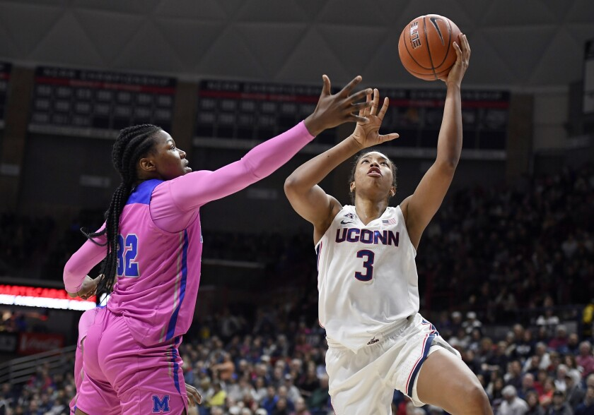 Connecticut's Megan Walker, right, shoots as Memphis' Dulcy Fankam Mendjiadeu defends in the first half of an NCAA college basketball game, Friday, Feb. 7, 2020, in Storrs, Conn. (AP Photo/Jessica Hill)