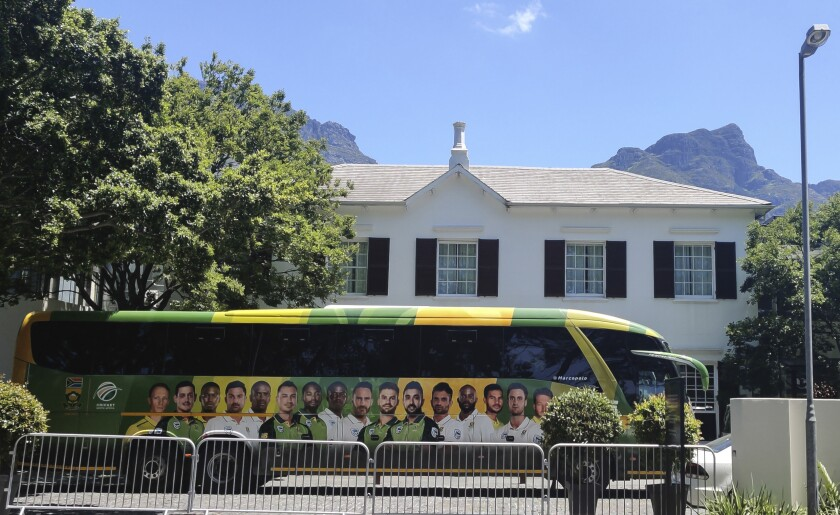 """The team bus for the South African cricket team is parked outside The Vineyard Hotel in Cape Town, South Africa, Sunday, Dec. 6, 2020. Two members of the England touring party in South Africa have returned """"unconfirmed positive tests"""" for COVID-19, the England and Wales Cricket Board said Sunday, as the first one-day international was canceled because of a virus outbreak at the hotel where both teams are staying. (AP Photo/Halden Krog)"""