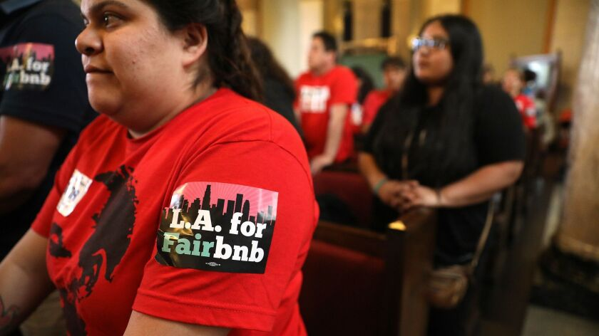 Genesis Diaz, 24, of South Los Angeles, attends a hearing on regulation of short-term rentals on April 10, 2018, at Los Angeles City Hall. The Los Angeles City Planning Commission voted Thursday on an updated version of the proposed rules.