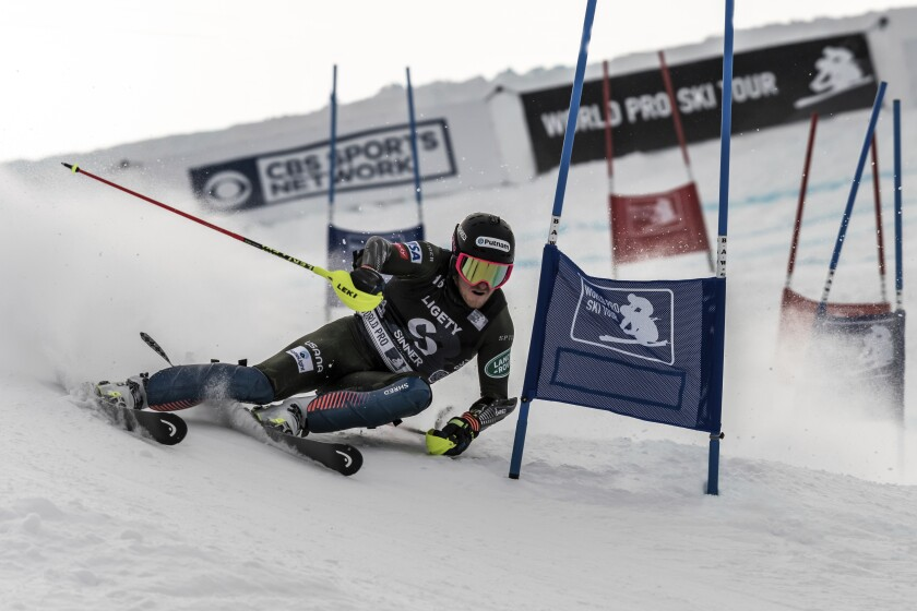 This photo provided by the World Pro Ski Tour shows Ted Ligety competing at Howelsen Hill at Steamboat Springs, Colo., on Jan. 2, 2020. The World Pro Ski Tour starts the season this weekend with a pair of races in Steamboat Springs, Colorado. The person you're competing against could be a national team member, World Cup competitor, college standout, journeyman or even two-time Olympic champion Ted Ligety, who's been known to make an appearance in the field. (Jace Romick/World Pro Ski Tour via AP)