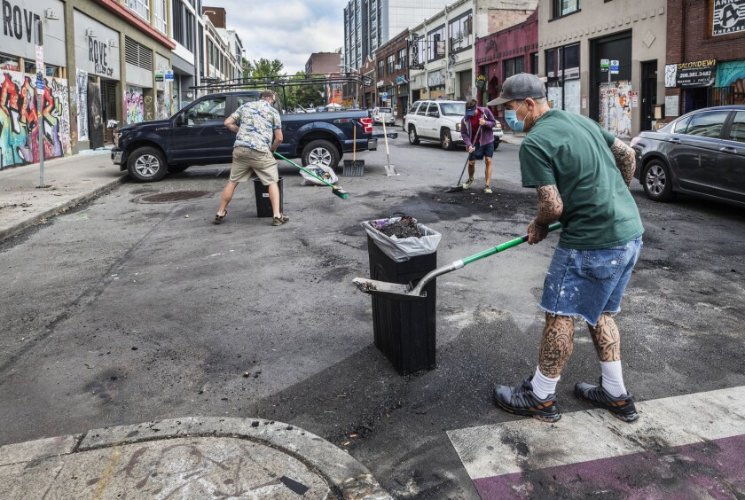 Workers clean up an intersection in Seattle