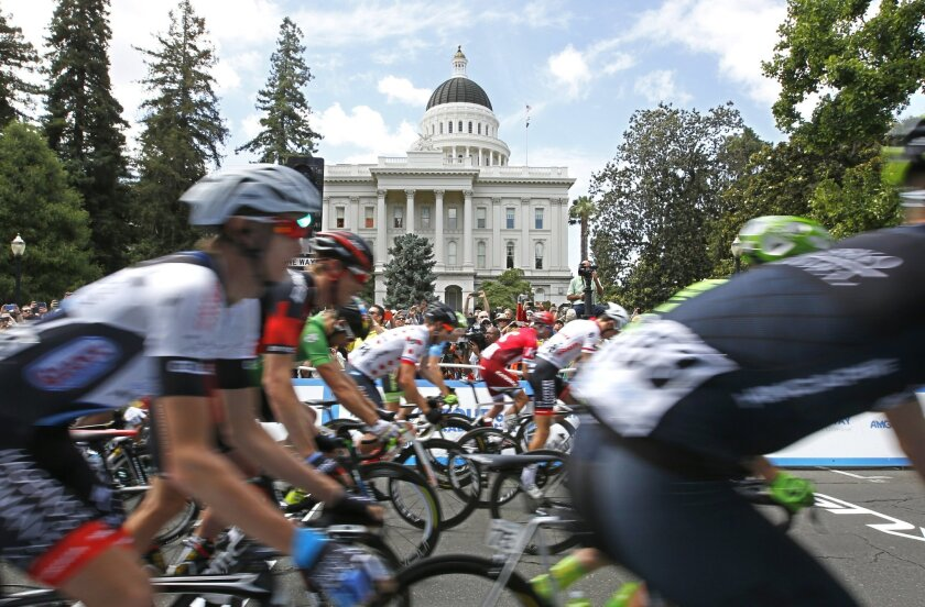 Cyclists pass the state Capitol as they begin the final stage of the Tour of California cycling race Sunday, May 22, 2016, in Sacramento, Calif. (AP Photo/Rich Pedroncelli)