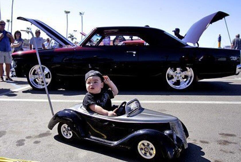 A replica of Grandpa's 1937 Ford allowed 19-month-old Mason Zennedijian of El Cajon to get around a car show in Del Mar. (Crissy Pascual / Union-Tribune)