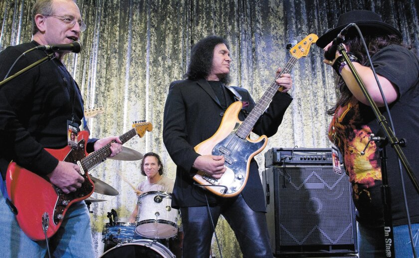 Gene Simmons (center), the KISS co-founder, bassist and singer, performs with campers. Simmons also gave advice on song writing.