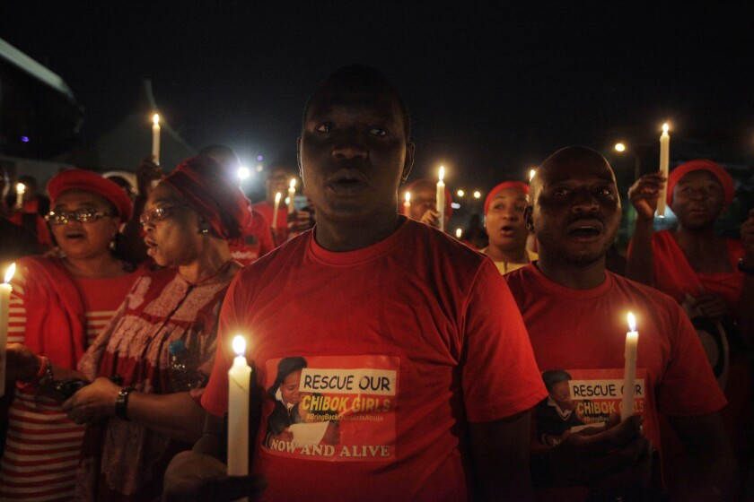Demonstrators in the Nigerian capital, Abuja, hold a candlelight vigil this week to mark a month of captivity for scores of kidnapped schoolgirls.