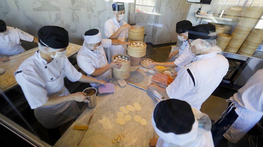 SAN DIEGO, CA 11/27/2018: Staff members make dumplings in Din Tai Fung, at the Westfield UTC, a new