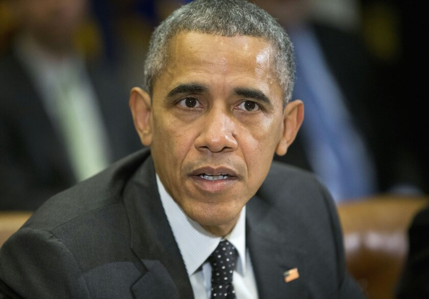 FILE - In this Feb. 9, 2016 file photo, President Barack Obama speaks in the Roosevelt Room of the White House in Washington. President Barack Obama has signed legislation imposing new sanctions against North Korea for refusing to stop its nuclear weapons program. (AP Photo/Pablo Martinez Monsivais