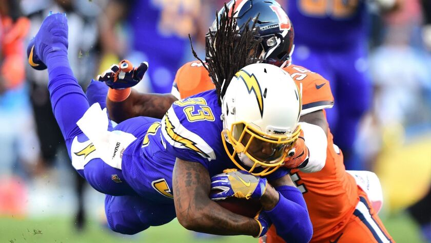 Chargers RB Dexter McCluster dives with the ball while tackled by Broncos linebacker Brandon Marshall at Qualcomm Stadium on October 13, 2016 in San Diego. (Photo by Harry How/Getty Images) ** OUTS - ELSENT, FPG, CM - OUTS * NM, PH, VA if sourced by CT, LA or MoD **