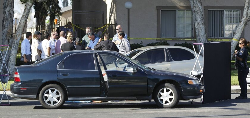 Police investigate the scene where a Border Patrol agent shot and killed a woman after she struck him with her car in Chula Vista Friday afternoon, according to authorities.