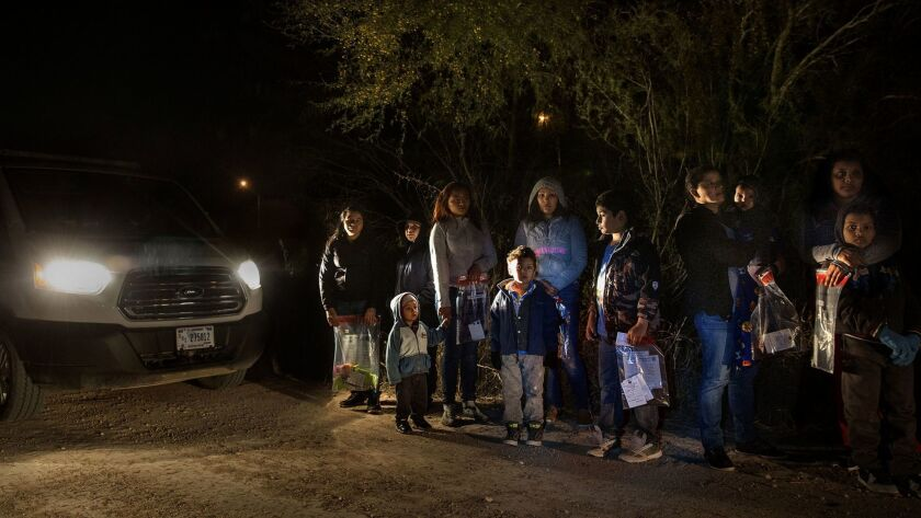 After crossing the Rio Grande River at night with the help of smugglers, group of mainly women and children from Central America are detained by U.S. Border Patrol agents before being taken into detention.