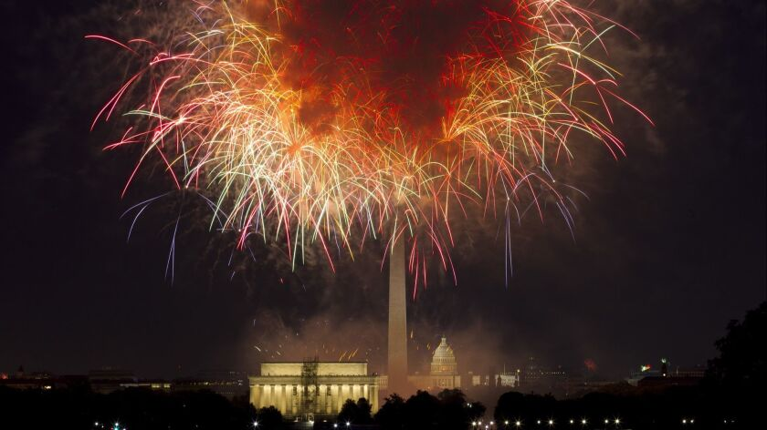 FILE - In this July 4, 2018, file photo, fireworks explode over Lincoln Memorial, Washington Monumen