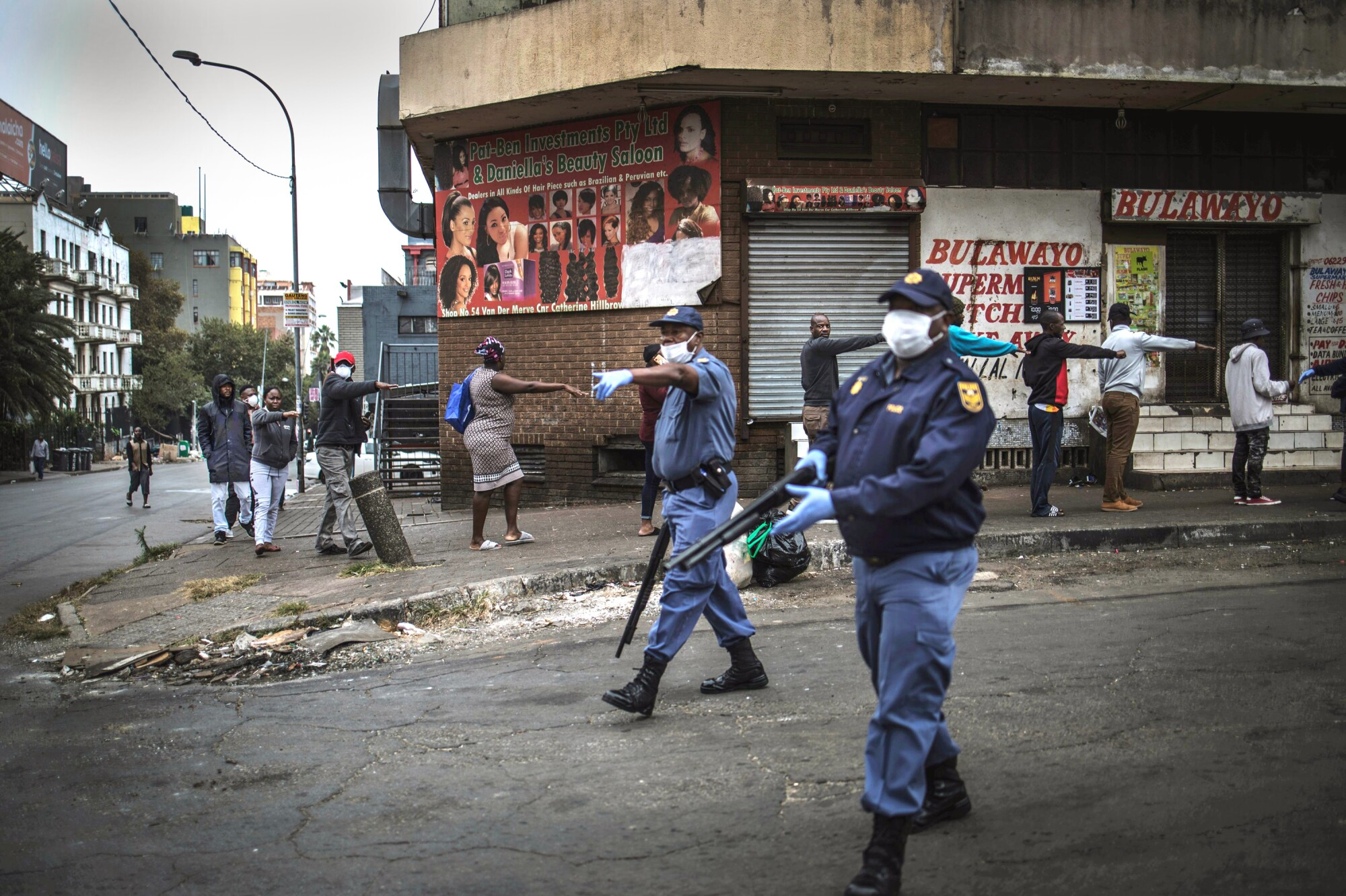Shoppers walk at least one meter apart in Johannesburg