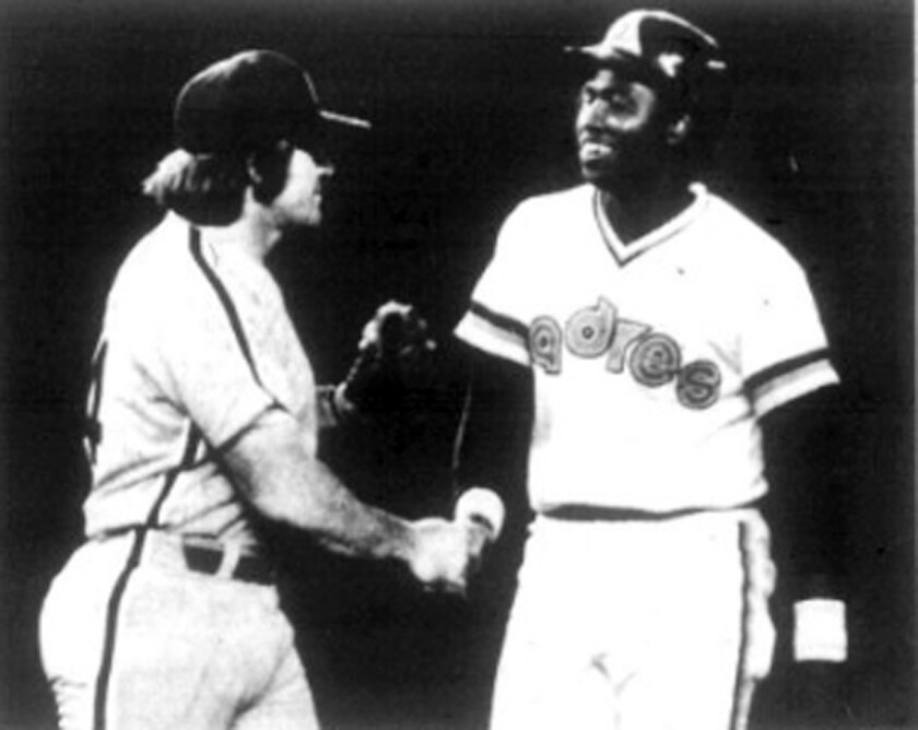 Phillies first baseman Pete Rose shakes hands with Tony Gwynn after an eighth-inning double for Gwynn's first major league hit, on July 19, 1982.
