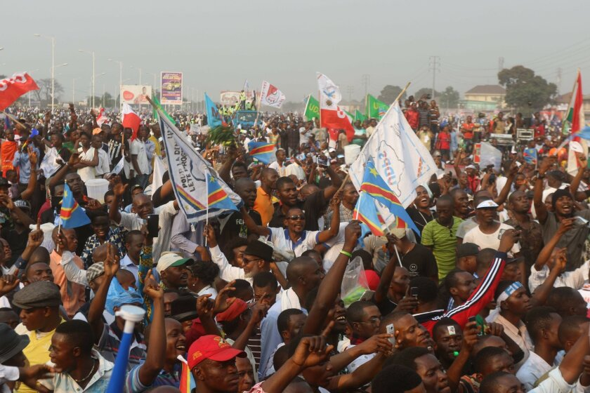 """Supportes of Congo opposition leader Etienne Tshisekedi during a political rally in Kinshasa, Congo, Wednesday, July 31, 2016. Several thousand people, many wearing the blue, yellow and red colors of Congo's flag, gathered near the Stadium of Martyrs in Kinshasa Sunday holding banners that said """"No"""