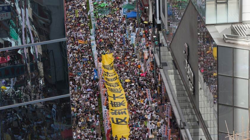 Thousands of protesters march through the streets of Hong Kong during a pro-democracy rally on July 1.