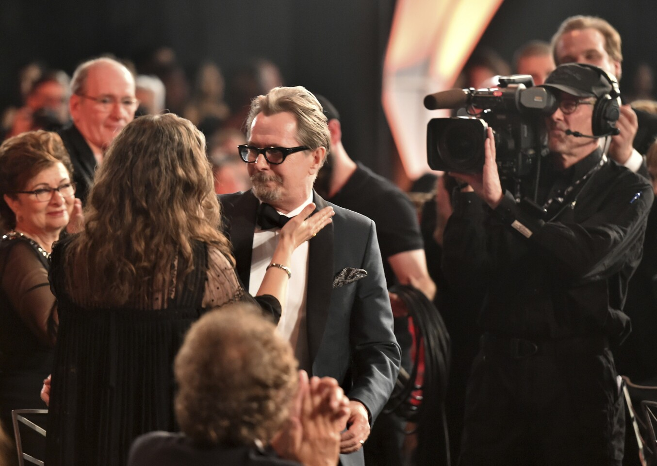 """Gary Oldman is congratulated in the audience as he accepts the award for outstanding performance by a male actor in a leading role for """"Darkest Hour"""" at the 24th annual Screen Actors Guild Awards at the Shrine Auditorium & Expo Hall on Sunday, Jan. 21, 2018, in Los Angeles."""