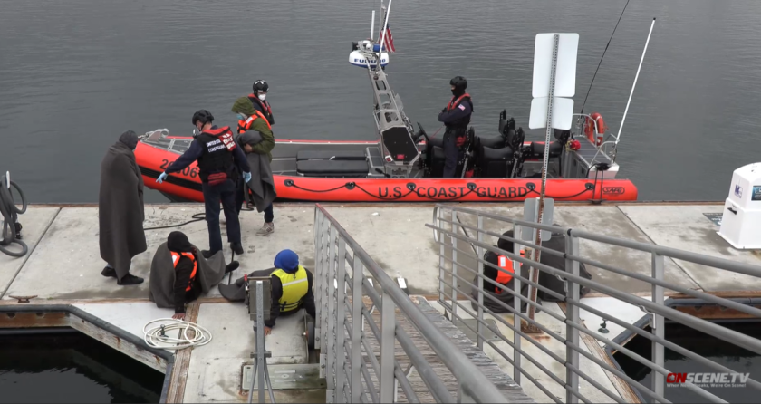 Twenty-three people were rescued from a suspected smuggling boat found near the coast of Sunset Cliffs early Monday.