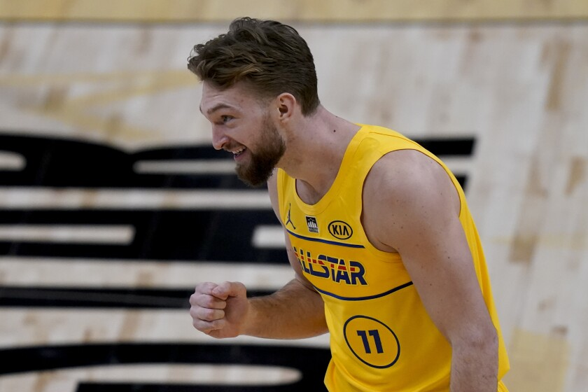 Indiana Pacers forward Domantas Sabonis celebrates during the skills challenge portion of basketball's NBA All-Star Game in Atlanta, Sunday, March 7, 2021. (AP Photo/Brynn Anderson)
