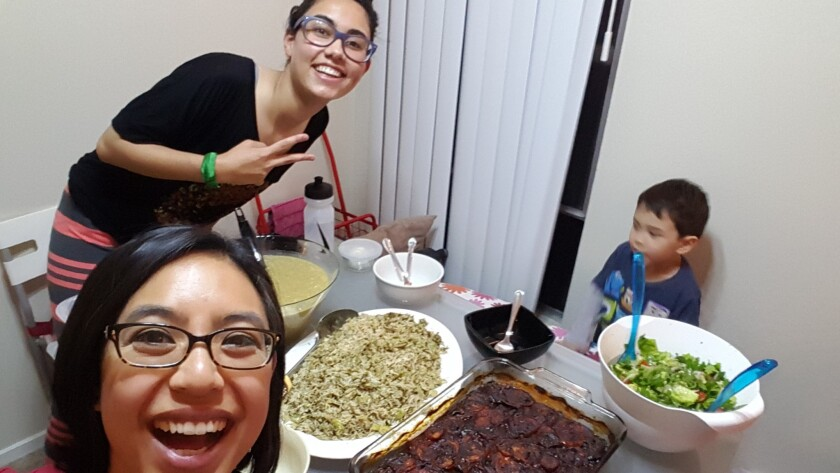 Susan St. Martin, at bottom, joins her friend Silver Al Khafaji for lentil soup with vermicelli noodles, dilly rice pilaf with fava beans, roasted eggplant with pomegranate molasses and tomatoes, and a mixed greens salad.