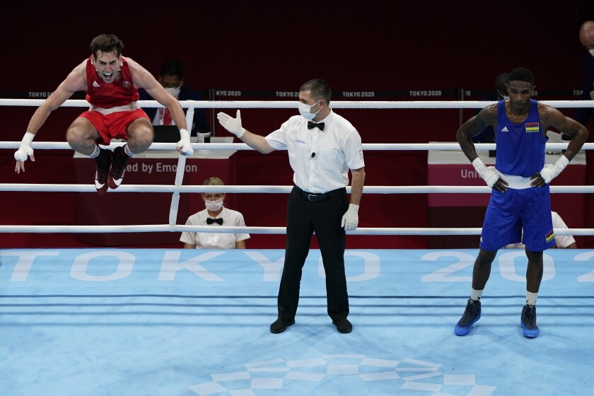 Ireland's Aidan Walsh, left, reacts after defeating Merven Clair, of Mauritius, Aidan Walsh, of Ireland, left, and Merven Clair, of Mauritius, in their welter weight 69kg quarterfinal boxing match at the 2020 Summer Olympics, Friday, July 30, 2021, in Tokyo, Japan. (AP Photo/Frank Franklin II)