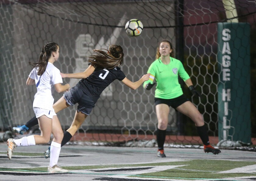 Sage Hill's Lexi Van den Bosch (5) nearly heads the ball in for a goal against Pacifica Christian on Jan. 7, 2020.
