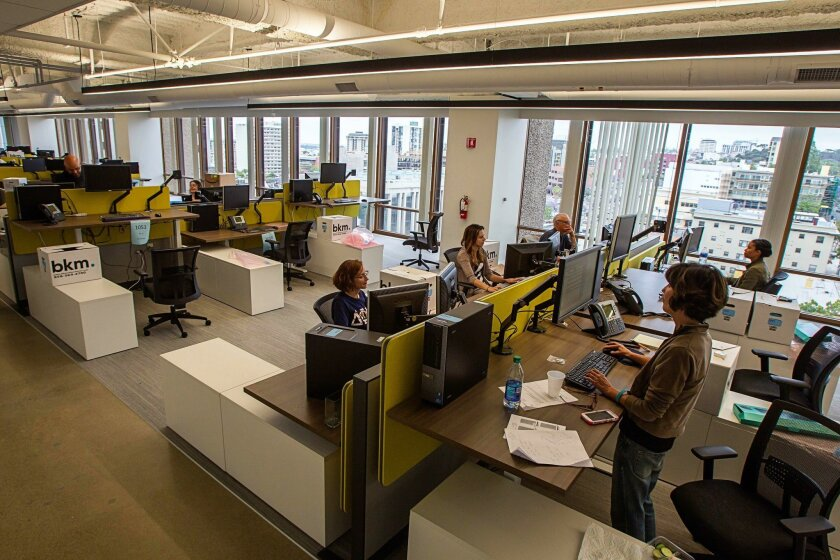 Newsroom staff members work Saturday on the 10th floor at 600 B St., with views of downtown and beyond, facing north.