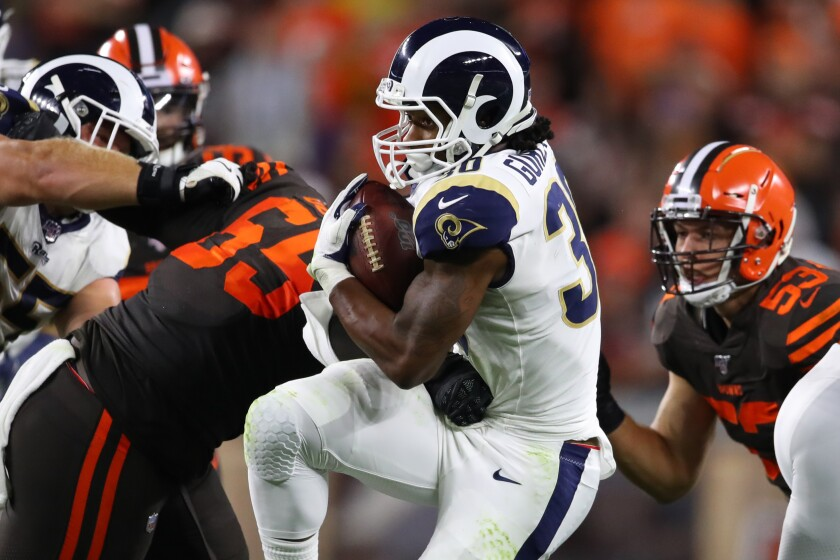 Running back Todd Gurley carries the ball against the Browns.