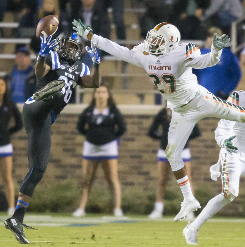Duke's Terrence Alls makes a catch in front of Miami's Corn Elder during the second half of an NCAA college football game, in Durham, N.C., Saturday, Oct. 31, 2015. (AP Photo/Rob Brown)