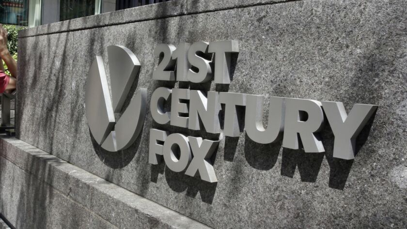 This Aug. 1, 2017, photo shows the 21st Century Fox sign outside of the News Corporation headquarter