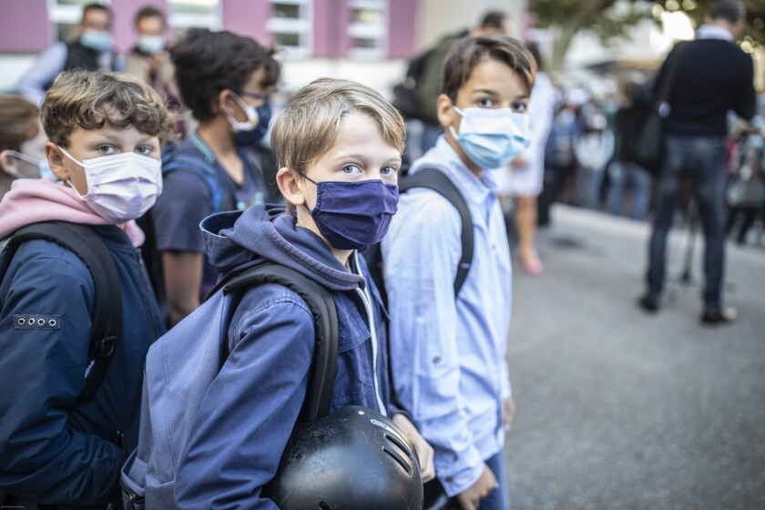 Children return to school in Strasbourg, eastern France, Thursday Sept. 2, 2021. France's virus situation has slightly improved in recent weeks, with about 17,000 confirmed cases of infection each day on average, down from more than 23,000 around mid-August. But many fear a reverse of the trend now that children are back to school. (AP Photo/Jean-François Badias)