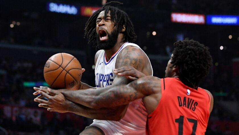 Portland Trail Blazers forward Ed Davis, right, reaches in on Clippers center DeAndre Jordan during the first half on Tuesday.