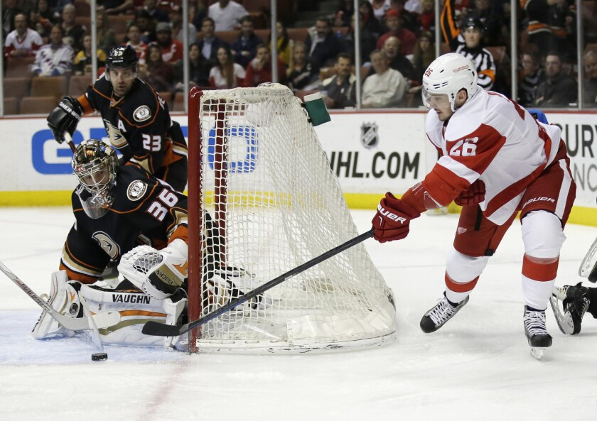 Ducks goalie John Gibson blocks a shot attempt by Red Wings forward Tomas Jurco during the first period.
