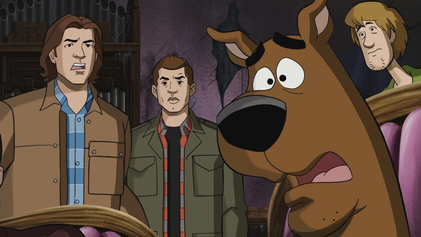 """Sam, left, and Dean (Jared Padalecki, Jensen Ackles) are transported into an animated world, with Scooby-Doo and Shaggy in a special episode of the CW's """"Supernatural"""" on KTLA."""
