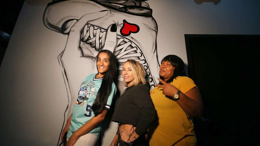 (L-R) Atifa Campbell, Jen Harvey and Zee Sham pose for a photo at World On Wheels in Los Angeles.