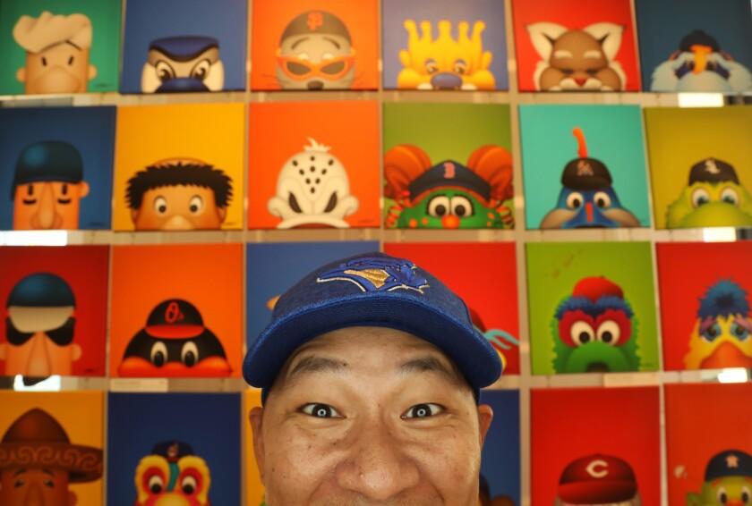 """ANAHEIM CA - JUNE 29, 2018 - S. Preston, a sports """"minimalist"""" artist, mimics the faces of his """"Mini"""