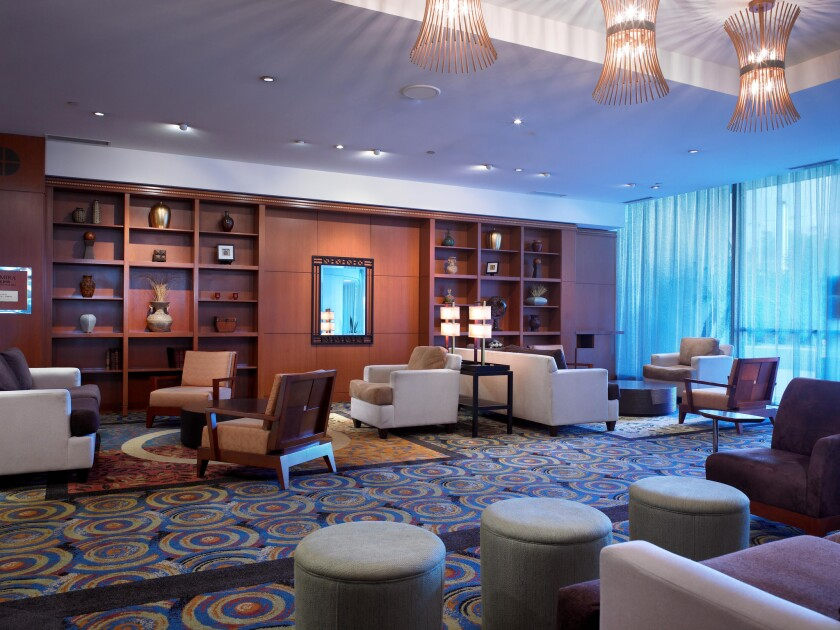 The lobby of the Concourse Hotel at Los Angeles International Airport. The hotel is undergoing a $65-million upgrade, with plans to emerge as a four-star Hyatt Regency in the fall.