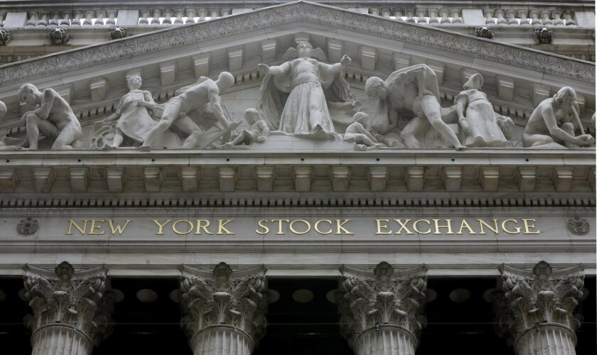 FILE - This Oct. 4, 2014, file photo, shows the facade of the New York Stock Exchange. Stock markets around the world edged higher Thursday, May 26, 2016, as traders interpreted the rise in oil prices to $50 a barrel for the first time this year as a positive sign for the global economy. (AP Photo/