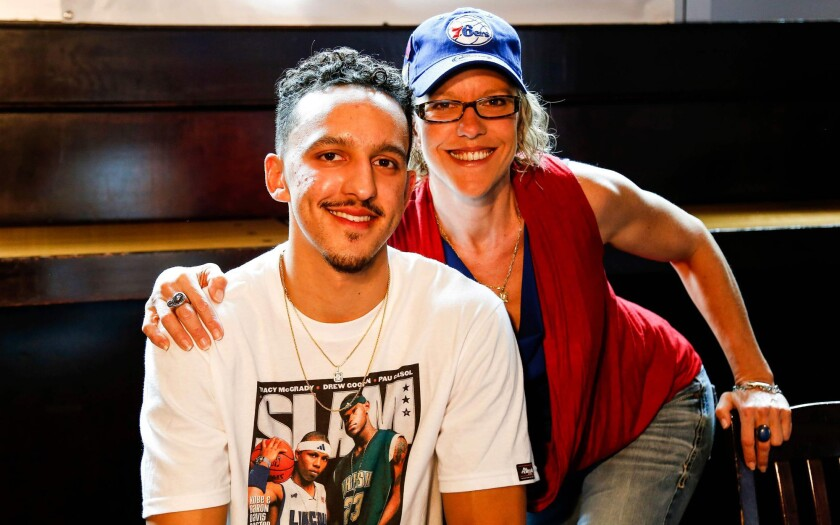Landry and Melanie Shamet pose for a photo after he joined the Philadelphia 76ers as a rookie.