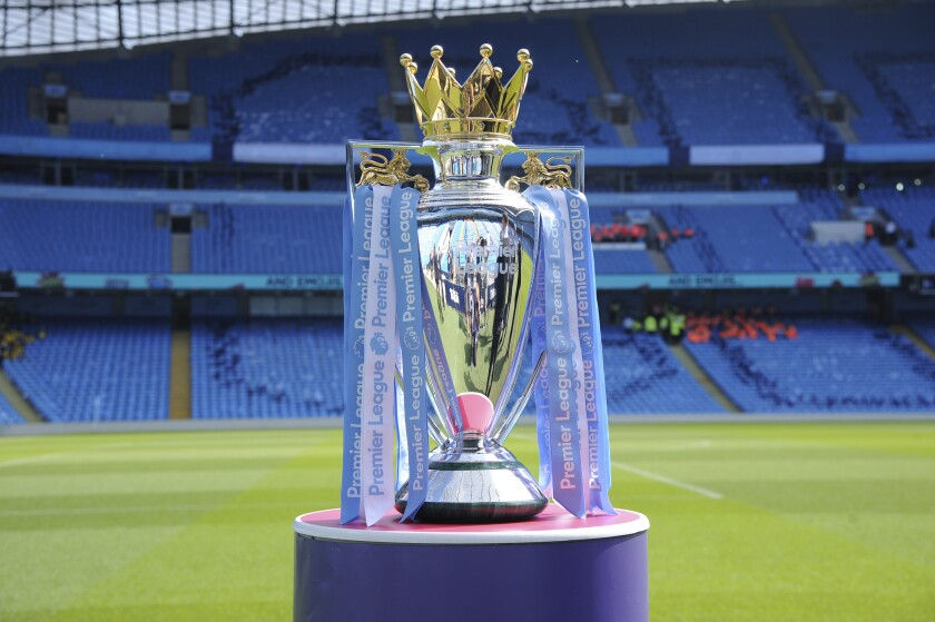 "FILE - In this Sunday, May 6, 2018 file photo, the English Premier League trophy is displayed on the pitch prior to the English Premier League soccer match between Manchester City and Huddersfield Town at Etihad stadium in Manchester, England. A Bournemouth player is one of two positive tests for COVID-19 to emerge from the Premier League's second round of testing, the club said on Sunday, May 24, 2020. The team said ""medical confidentiality means the player's name will not be disclosed"" and added that he will self-isolate for seven days before being tested again at a later date. The league tested 996 players and club staff on Tuesday, Thursday, and Friday. (AP Photo/Rui Vieira, File)"