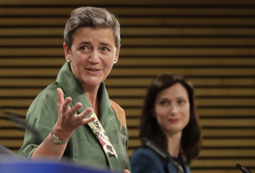 European Commission Vice-President Margrethe Vestager, left, and European Innovation Commissioner Mariya Gabriel participate in a media conference on the digital education action plan at EU headquarters in Brussels, Wednesday, Sept. 30, 2020. (Olivier Hoslet, Pool via AP)