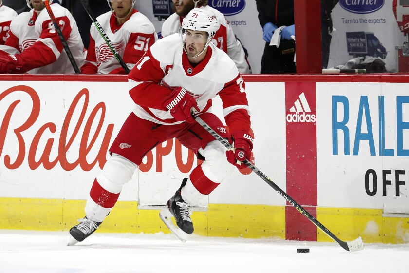 FILE - In this April 12, 2021, file photo, Detroit Red Wings' Dylan Larkin (71) moves the puck against the Carolina Hurricanes during the first period of an NHL hockey game in Raleigh, N.C. Larkin says he has never been this excited about the team during training camp. (AP Photo/Karl B DeBlaker, File)