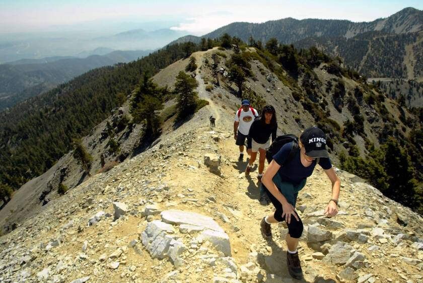 Hikers ascend to the top of Mt. Baldy. Routes to the summit are closed through April 30.