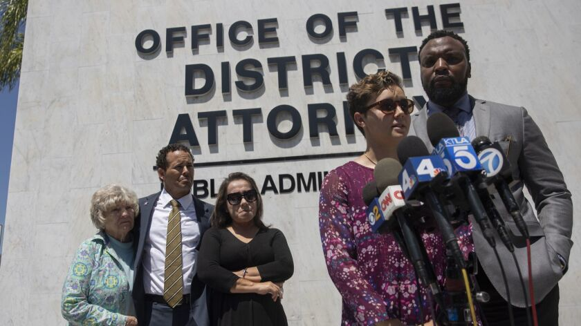 Nyla Williams, 19, the sister of Hannah Williams, speaks at a news conference outside the Orange County district attorney's office on Thursday. At right is civil rights attorney S. Lee Merritt, and her family listens in the back.