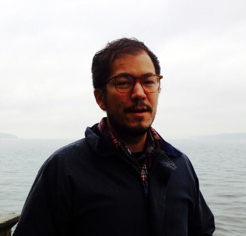 A portrait of public artist and activist Rosten Woo.