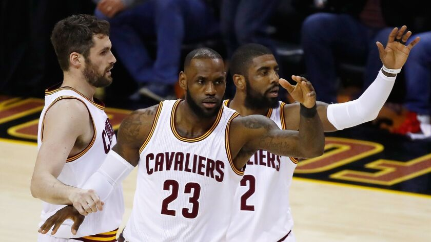CLEVELAND, OH - JUNE 09: Kevin Love #0, LeBron James #23 and Kyrie Irving #2 of the Cleveland Cavali