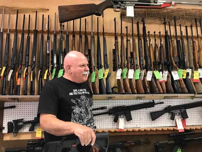 Sam Scarmardo, head of the Mohave County GOP, at his gun store in Lake Havasu City, Ariz.